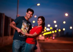 Couples glowing in street light
