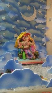 Ganesha in the middle of clouds and stars