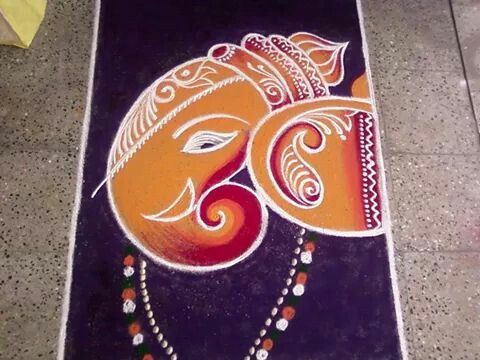 Orange with Red Ganesa Face rangoli