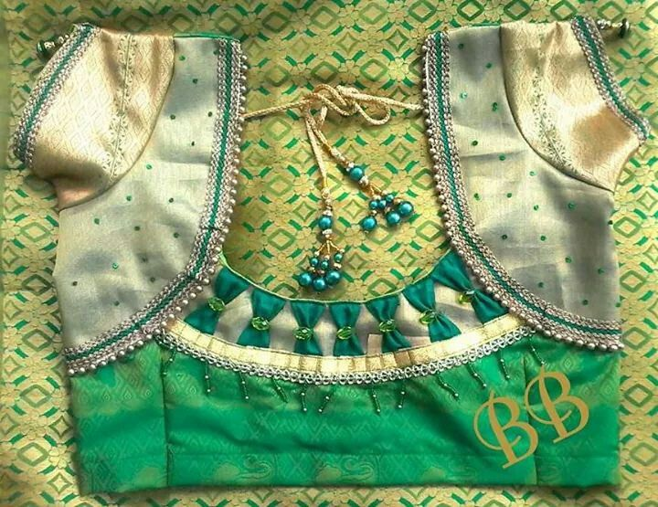 16. Green Blouse with Silver patch work