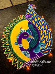 Violet and Yellow color Peacock Rangoli