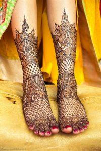 21. Paisley and peacock bridal feet mehndi