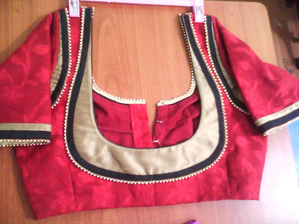 24. Red blouse with Golden patch work