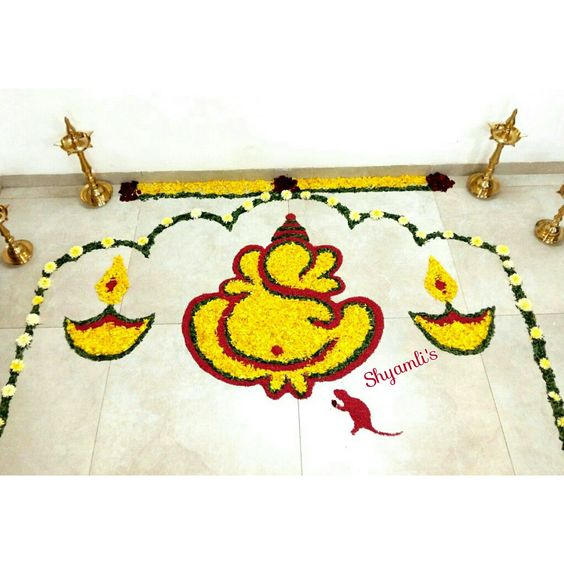 Ganesh rangoli with SunFlower