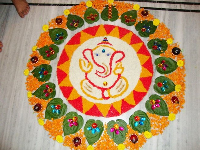 Ganesh rangoli with betal leaves