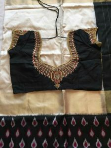 35. Black blouse with silver jardosi and stone maggam work blouse