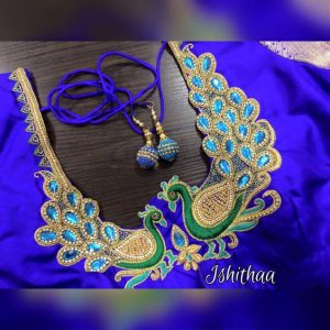 36. Cute double peacock maggam work blouse