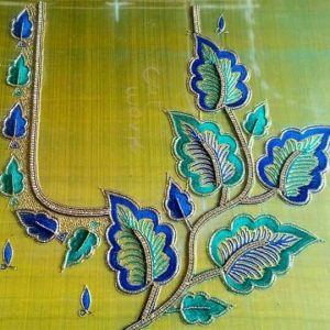 38. Blue and green blouse maggam work blouse