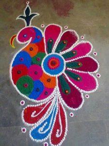 Peacock rangoli using old cd's
