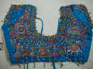 52. Blue blouse with varali work maggam design