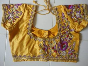 53. Intricate blouse border maggam work with golden zari