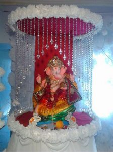 7. Dancing Ganesha Decoration in beautiful white theme madapam