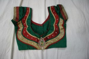 8. Green Blouse with red and gold color patch work