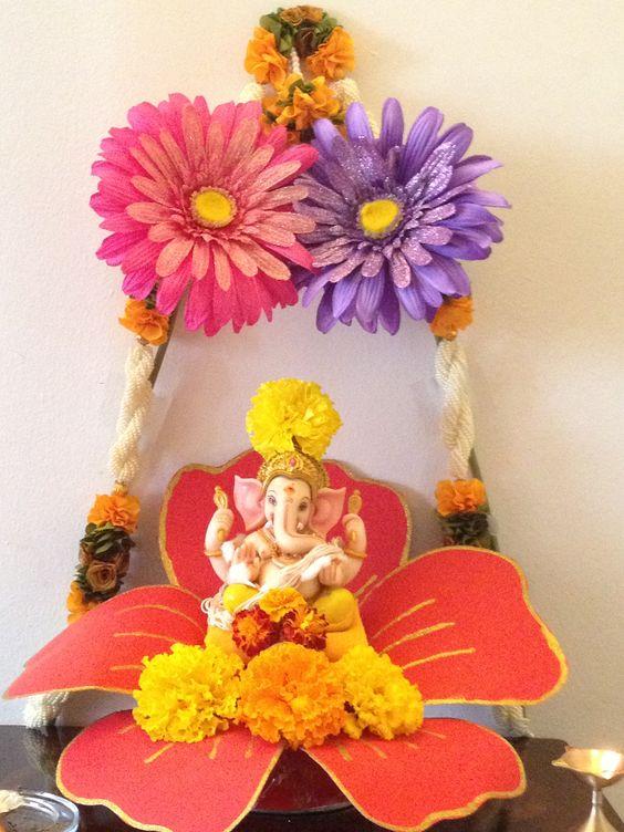 Ganesha placed above big flower