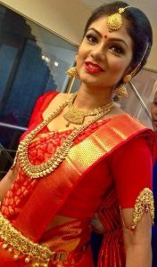 11. Red Silk saree with golden checked border
