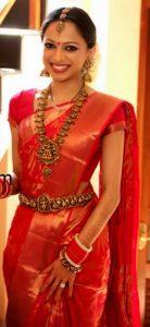 12. Red flower silk saree with golden plain border