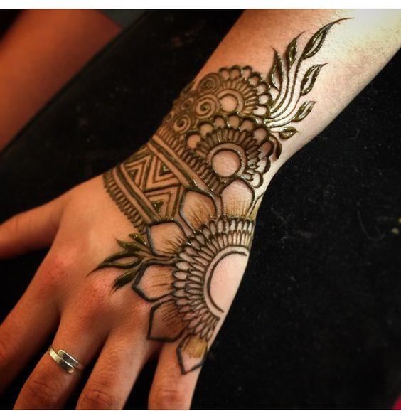 15. Broad henna back hand design