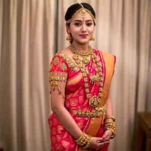 21. Thilagam Design in Red silk saree with plain border