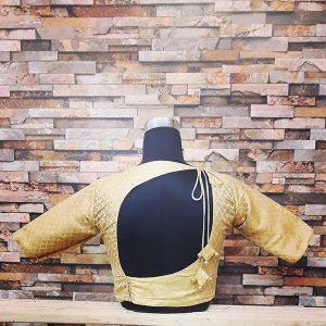 25. Golden banaras back neck blouse