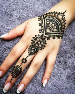 29.Middle finger back henna design