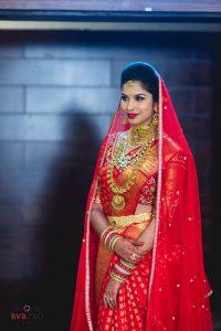 30. Red silk saree with golden Buttas