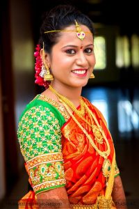 38. Red silk saree with green checked blouse