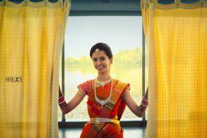43.Red silk saree with mango and line design
