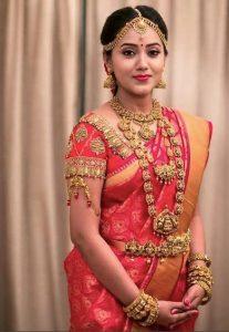 5. Thilagam design in Red Kancipuram Silk Saree