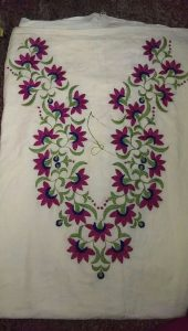 7. White Top with Red Flowers and Green Leaves