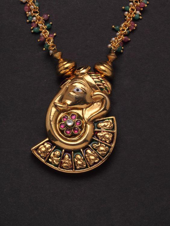 7.Ganesha Inspired Kundan stone Pendant