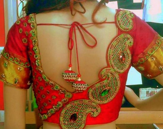 Blouse back neck design with stone work and paisleys