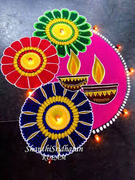 2.Two Diya's with flowers