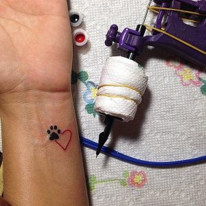 33.Pet paw and Heart Tattoo