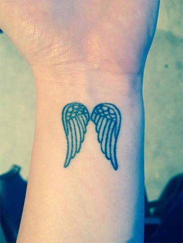 36.Angel Feather Tattoo