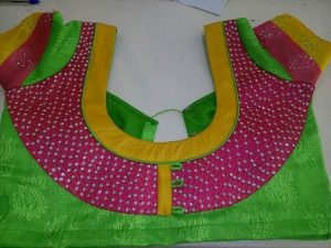 33.Green blouse with yellow and pink work