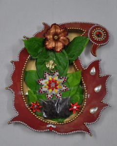 13.Ganesha with betel leaves