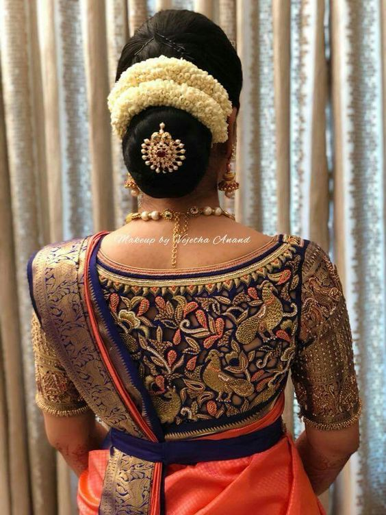 13.Simple bun hairstyle with two line gajra