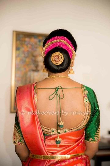 2.Large low bun with red and gold gajra
