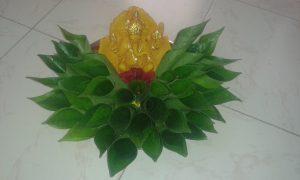 21.Yellow ganesha with betel leaves decoration