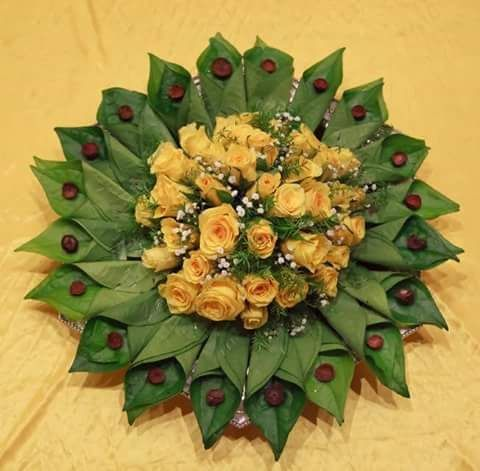 26.Betel leaf plate decoration with yellow rose