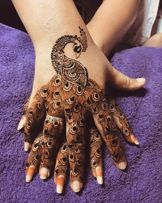 1.Trendy Peacock Back Hand Mehndi