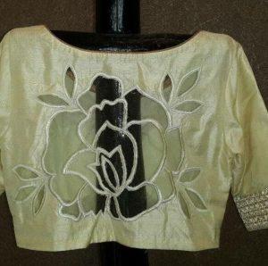 15.Beautiful cut work rose high back neck blouse design