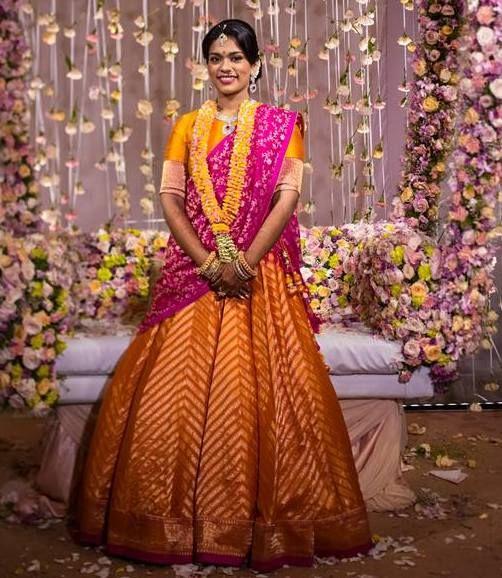 34.Mango yellow with pink bridal lehnga