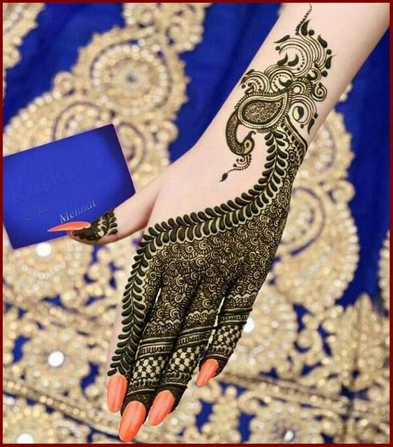 40.Back hand design with Peacock Mehndi