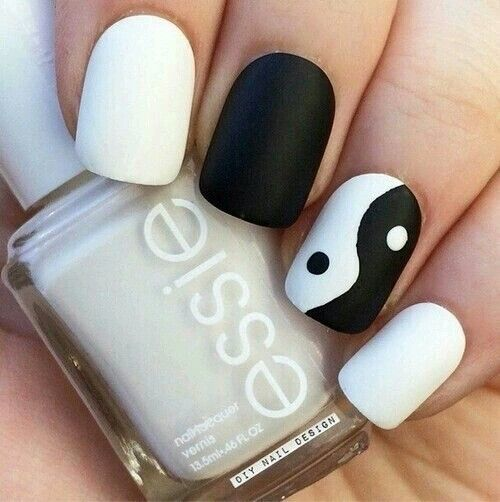 41.Cute white and black nail art