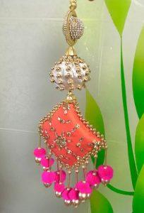 10.Orange tassel with pink balls