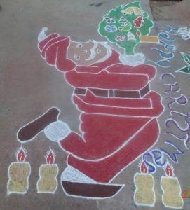 19.santa holding christmas tree rangoli