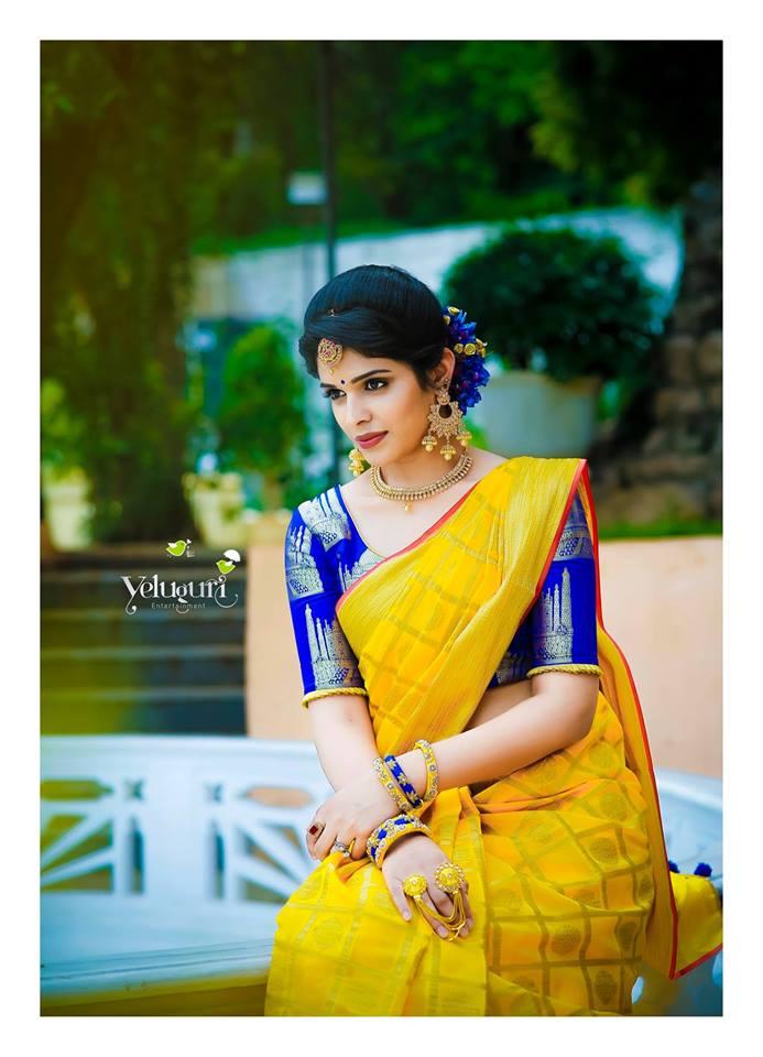 Yellow silk saree with royal blue blouse