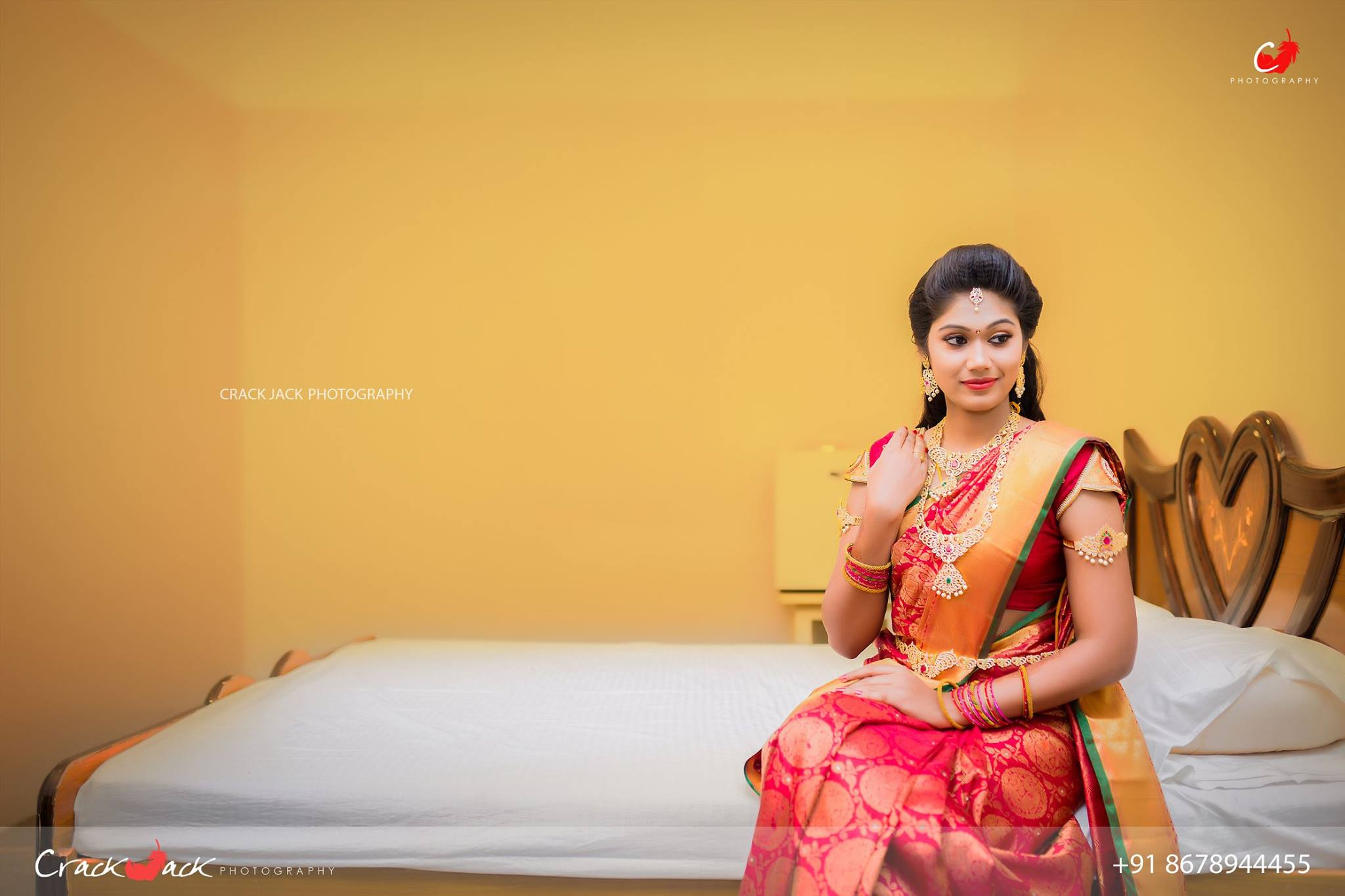 Red silk saree with round gold prints