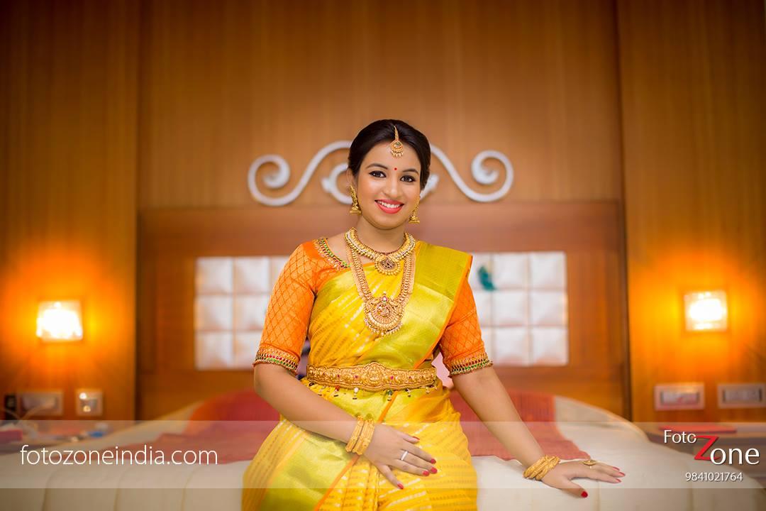Yellow saree with Orange Blouse